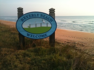coral sand behind sign that reads beverly beach welcome