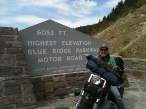 nick sharpe on his harley davidson motorcycle in front of marker  that reads 6350 feet elevation